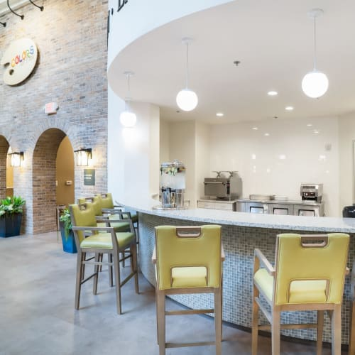 Open lounge areas and bar space for residents at Celebration Village Forsyth in Suwanee, Georgia