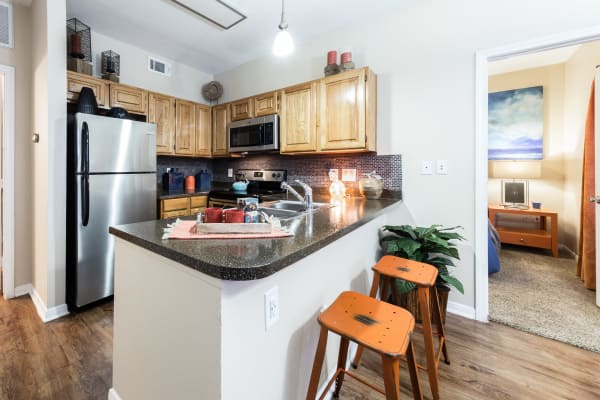 Luxury kitchen with breakfast bar at Pavilions at Northshore in Portland, Texas