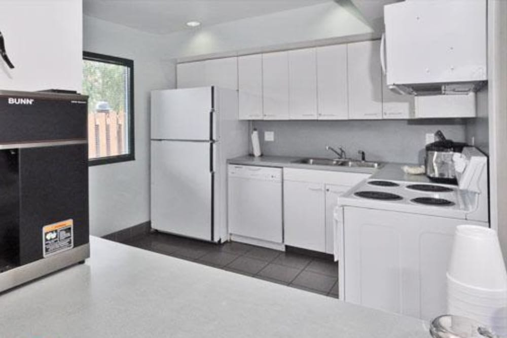 Kitchen with appliances at French Colony Apartments in Lafayette, Louisiana