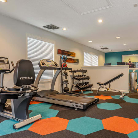 Fitness center at City Center Station Apartments in Aurora
