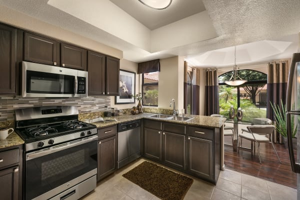Large luxury kitchen and dining room at San Cervantes in Chandler, Arizona