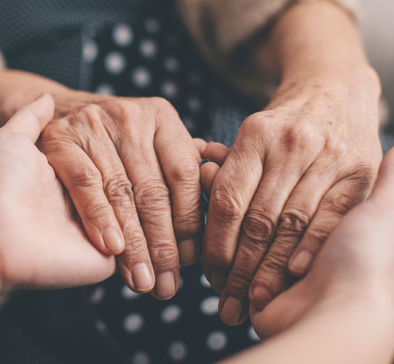 A caretaker holding a resident's hands at Sandpiper Courtyard in Mt. Pleasant, South Carolina