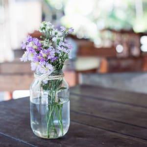 Purple flowers in a mason jar at EVIVA Midtown in Sacramento, California