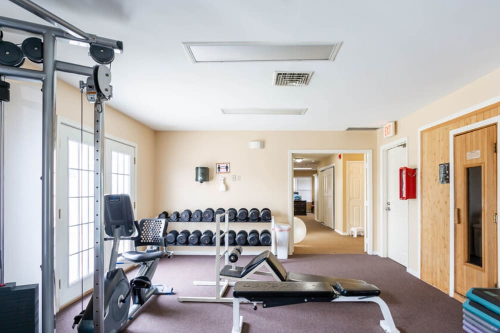 Fitness center with sauna at Bennington Hills Apartments in West Henrietta, New York