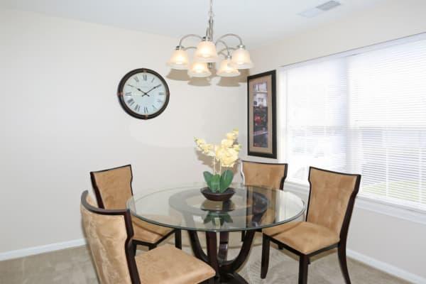An apartment dining at Bennington Hills Apartments in West Henrietta, New York