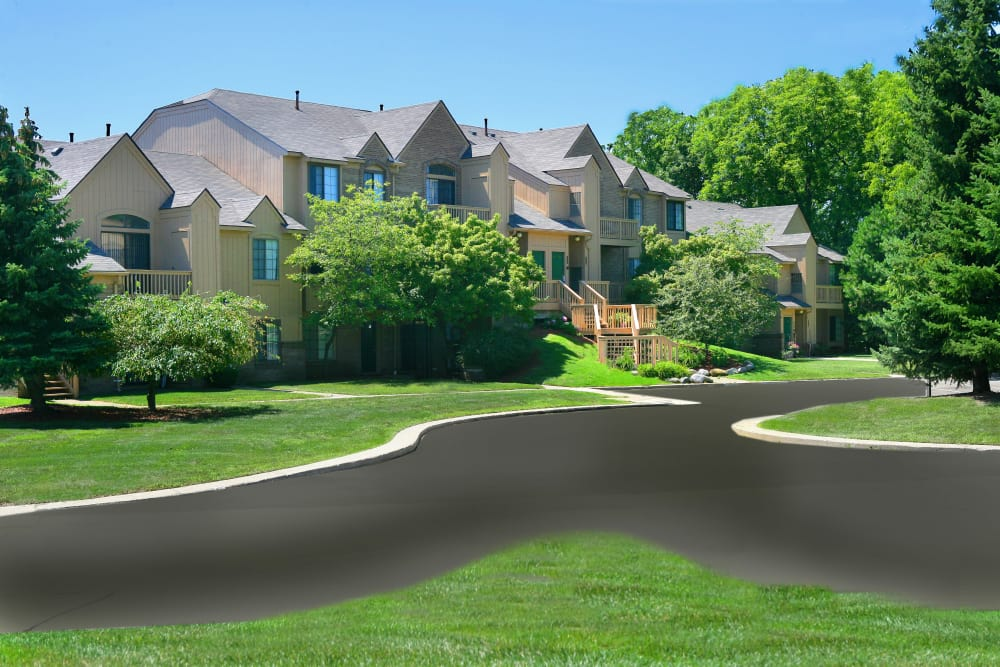 Roads winding through our beautifully maintained neighborhood at Saddle Creek Apartments in Novi, Michigan