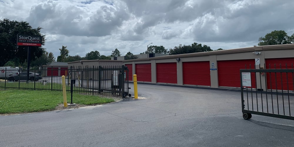 The gated main entrance to StorQuest Self Storage in Odessa, Florida