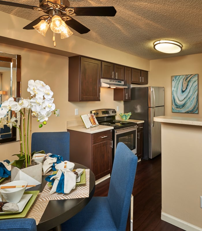 brown kitchen and dining room, model unit at Alton Green Apartments in Denver, CO