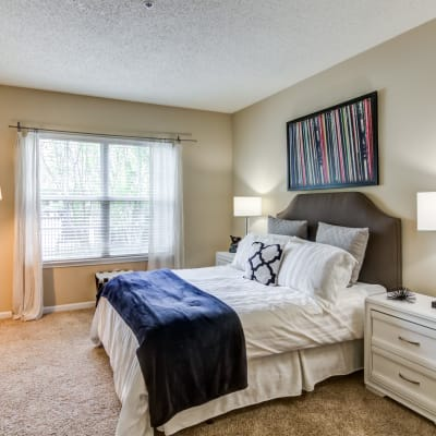 Bright bedroom with beige walls at Sofi Parc Grove in Stamford, Connecticut