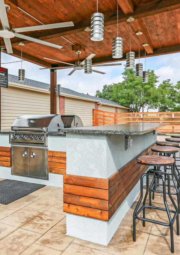 Covered BBQ area with bar top seating at Skyecrest Apartments in Lakewood, CO