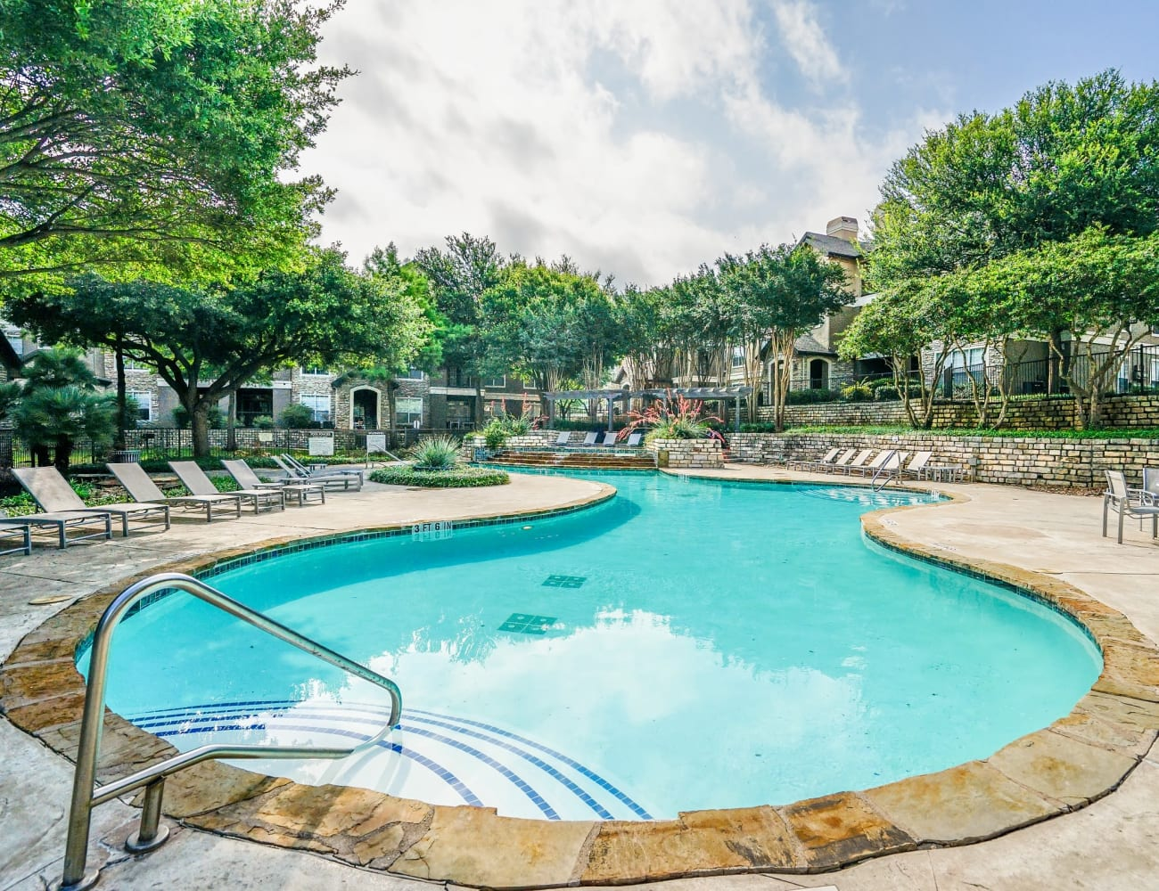 Resident clubhouse and pool with ample seating and more at Beck at Wells Branch in Austin, Texas