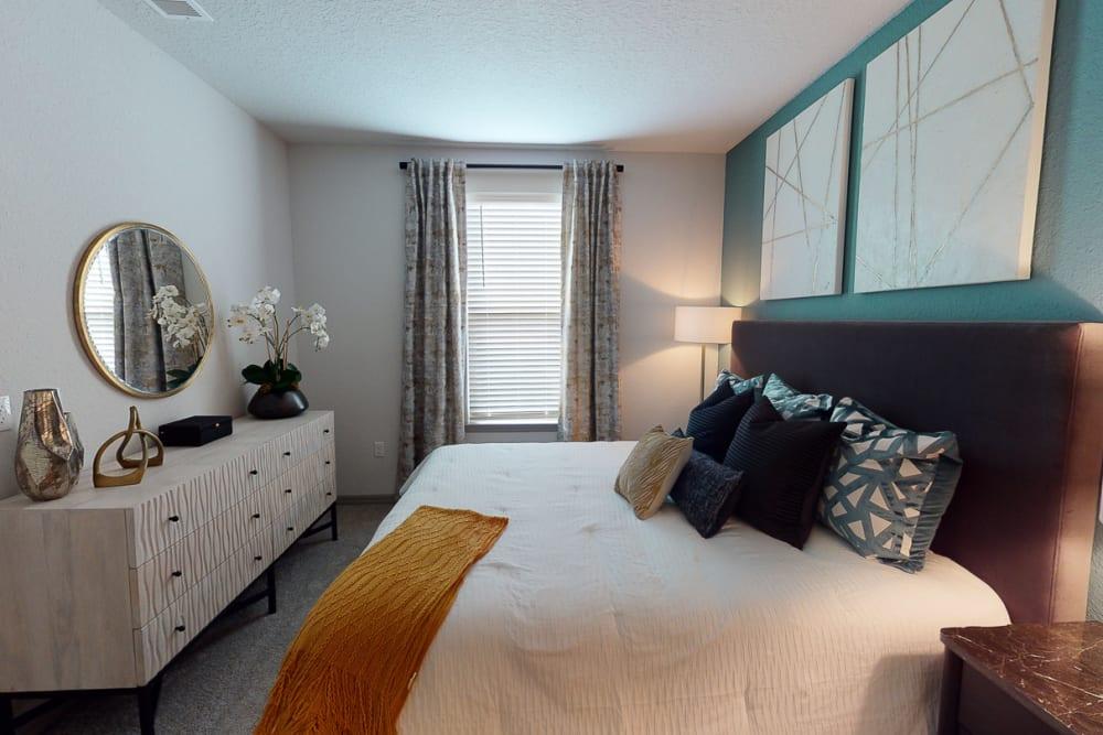 Model bedroom at Integra 289 Exchange in DeBary, Florida