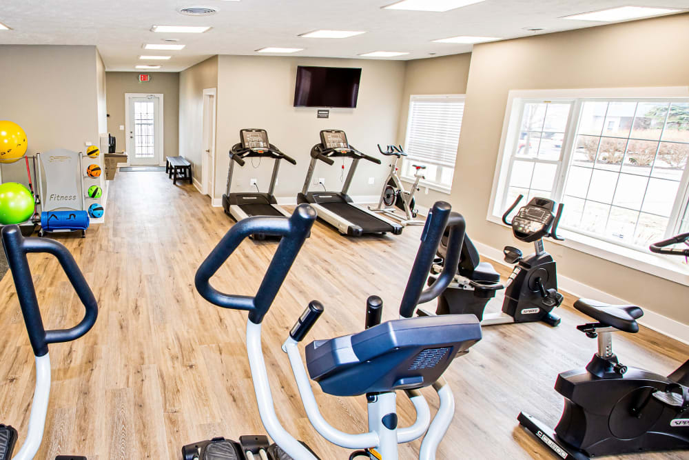A fitness center with lots of natural lighting at Silver Lake Hills in Fenton, Michigan