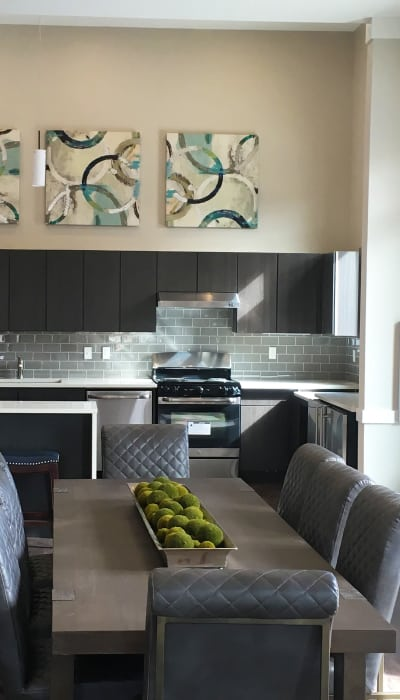 Modern design elements in a kitchen and dining area at The Reserve at Couret Farms in Lafayette, Louisiana