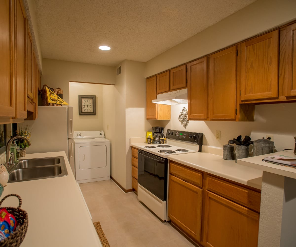 Kitchen with a washer and dryer at Polo Run Apartments in Tulsa, Oklahoma