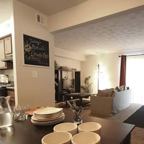 Spacious dining and living area in a model apartment home at Lakeside Landing Apartments in Lakeside Park, Kentucky