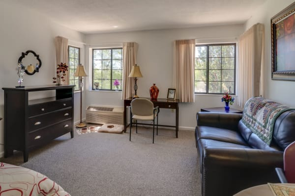 Assisted living apartment living room at Harmony Gardens in Warrensburg, Missouri