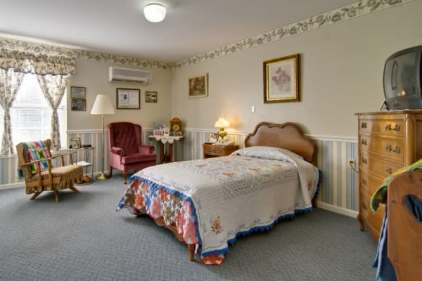 Assisted living apartment bedroom at Ravenwood Terrace Senior Living in Moberly, Missouri