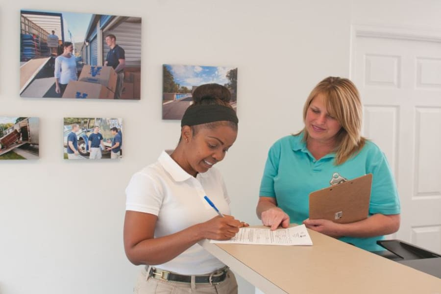 Professional manager helps a customer at Virginia Varsity Storage in Christiansburg, Virginia