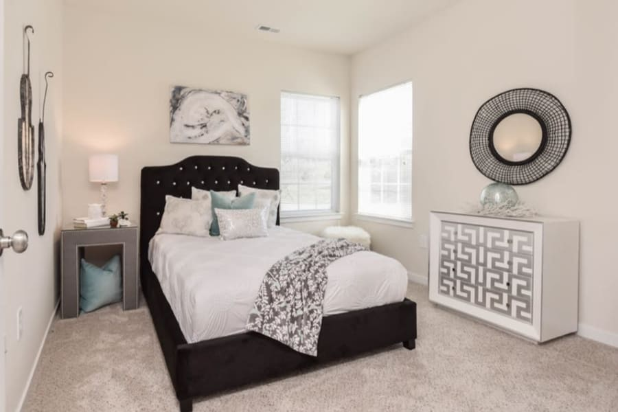 Large resident bedroom at Aventura at Towne Centre in Ellisville, Missouri.