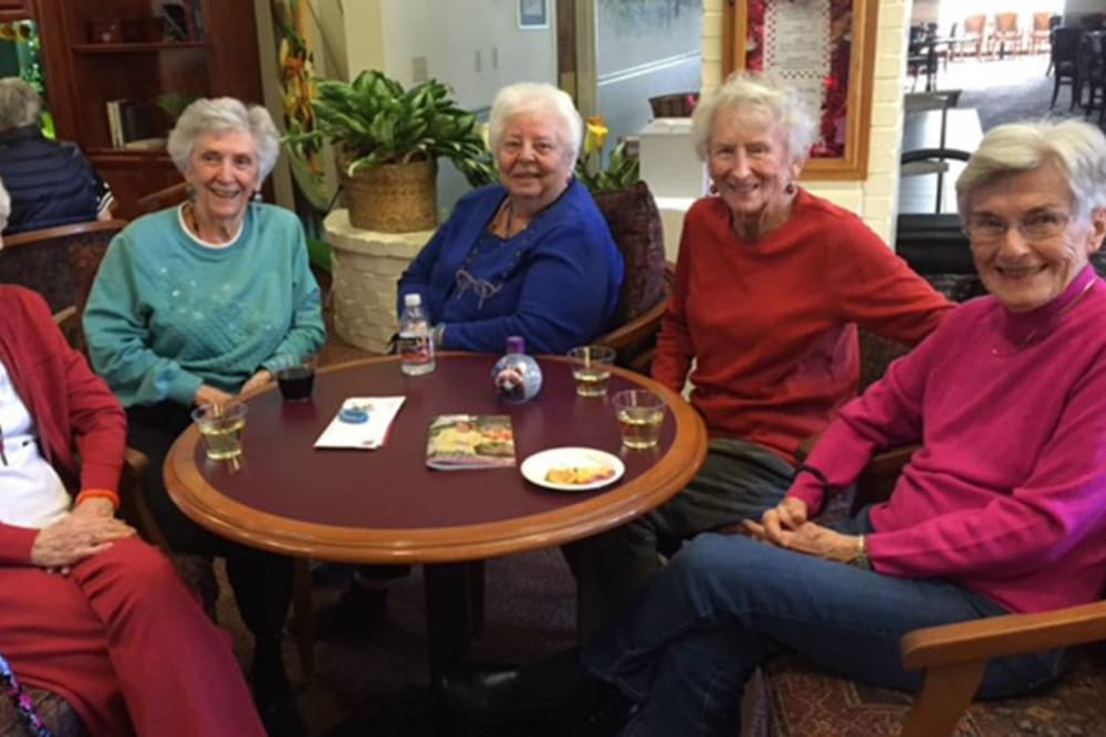 Resdients Enjoying a Drink at Hilltop Commons Senior Living in Grass Valley, California