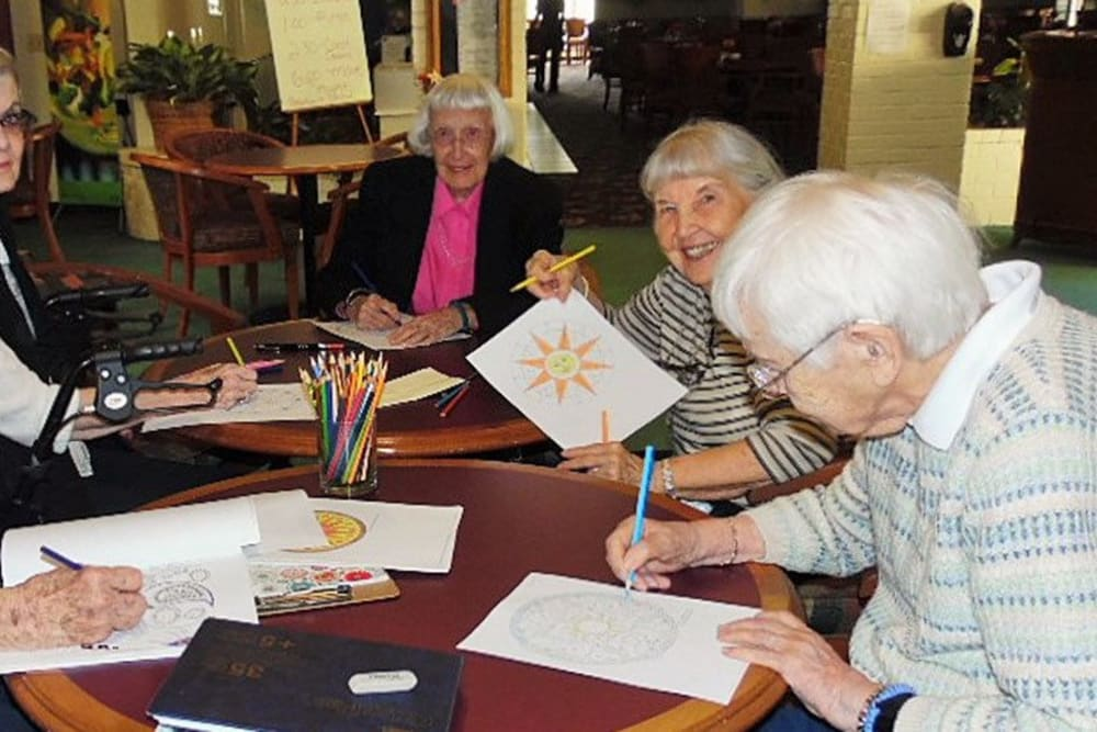 Residents coloring together and having a great time at Hilltop Commons Senior Living in Grass Valley, California