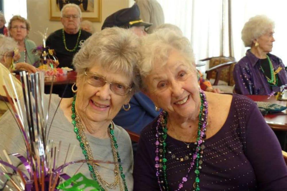Happy friends posing for a photo at Roseville Commons Senior Living in Roseville, California