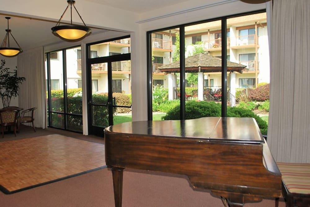 Piano area for residents to enjoy music at Roseville Commons Senior Living in Roseville, California