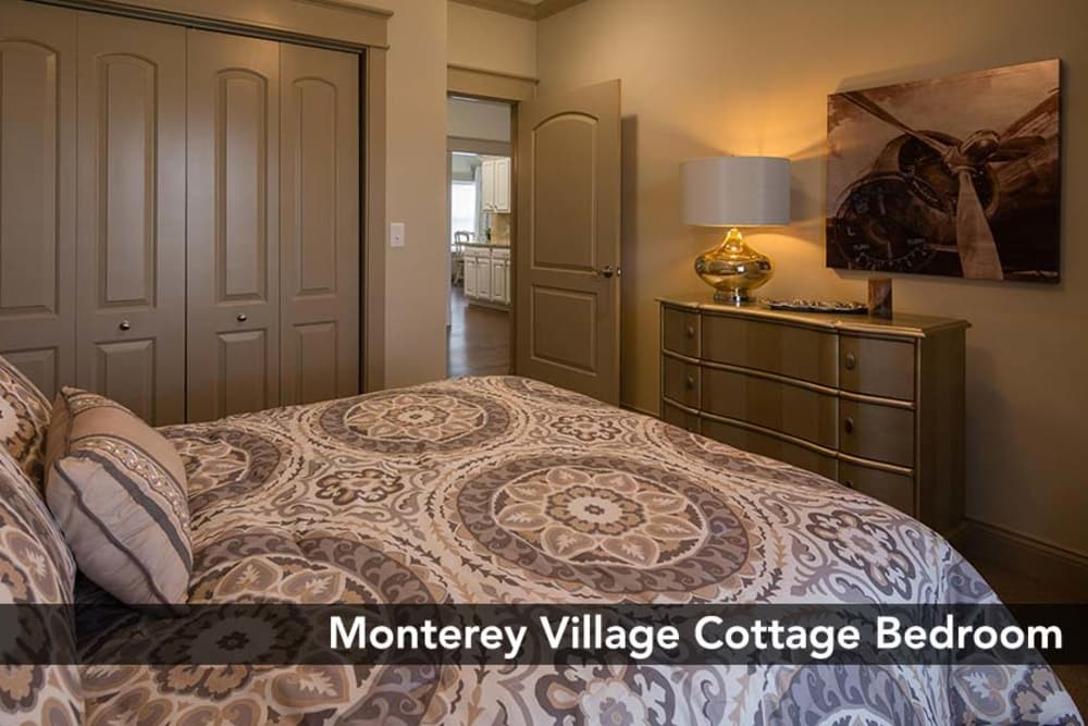 Cozy bedroom with accent lighting at Monterey Village Senior Living senior living community in Lawrence, Kansas