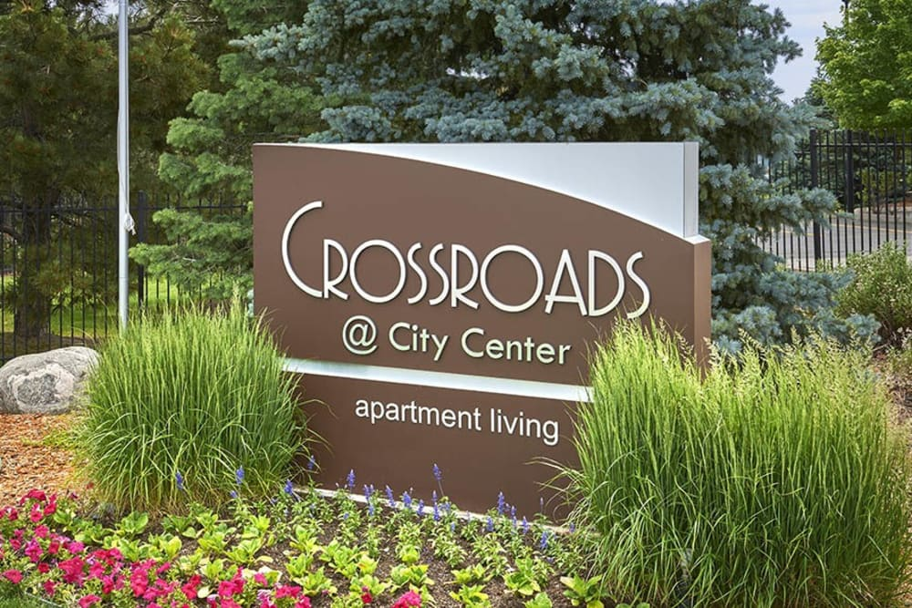 The front sign at Crossroads at City Center Apartments in Aurora, Colorado