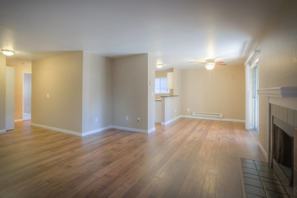 Model home at Chestnut Hills Apartments in Puyallup, Washington featuring a spacious floor plan layout with hardwood floors
