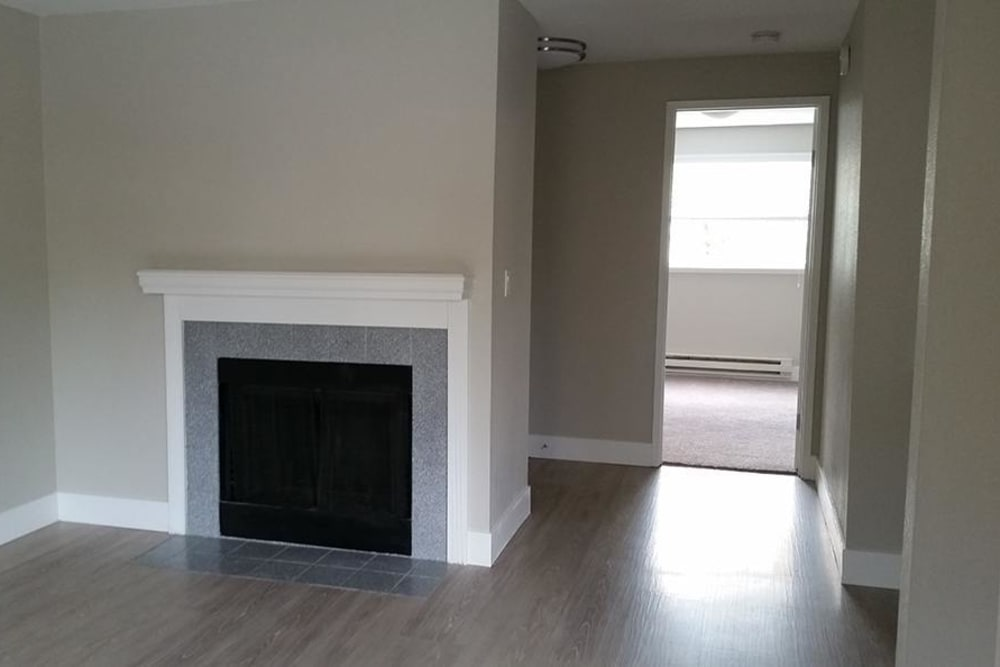 Chestnut Hills Apartments model home with hardwood floors and fireplace in Puyallup, Washington
