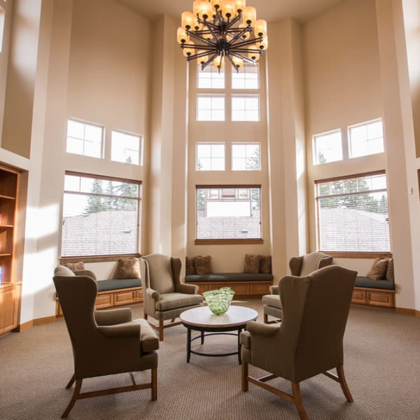 Sunlit reading room at Quail Park of Lynnwood in Lynnwood, Washington