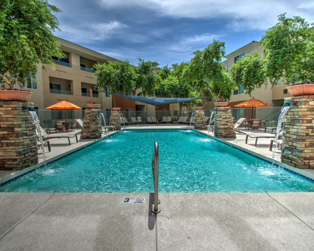 Shimmering pool on a sunny day at Sage Luxury Apartment Homes in Phoenix, Arizona