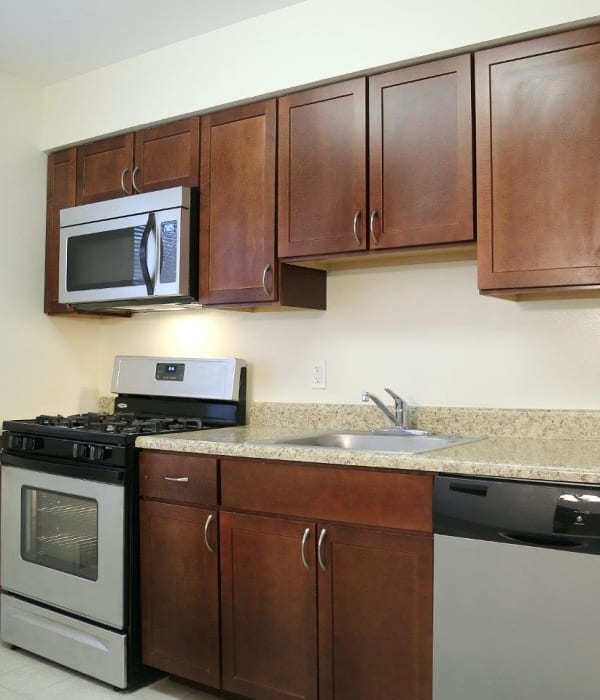 Wood style cabinets in the kitchen with tons of space on counters for cooking and baking at Eagle Rock Apartments at North Plainfield in North Plainfield, New Jersey