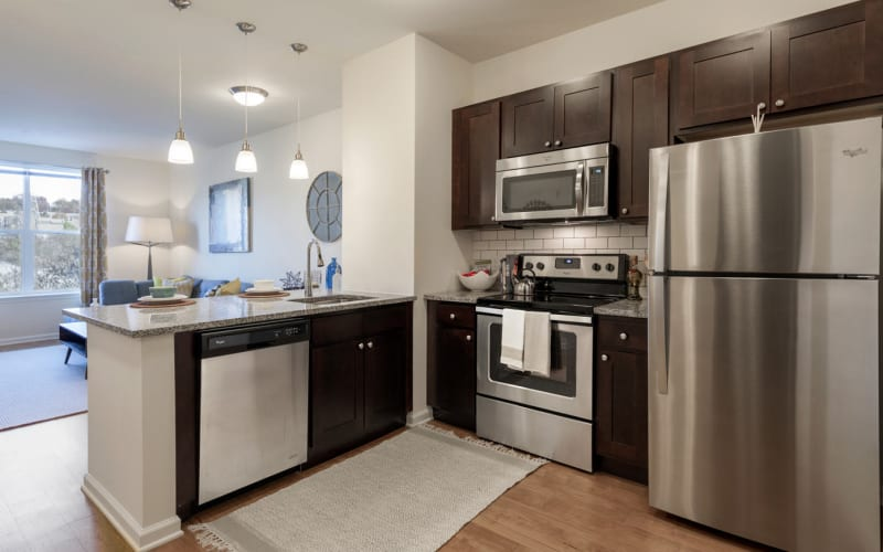Bright kitchen with stainless steel appliances at The Royal Athena in Bala Cynwyd, Pennsylvania
