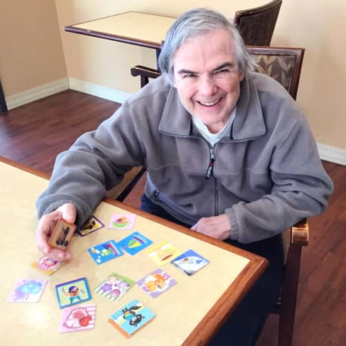 A Resident playing a matching game at Oxford Glen Memory Care at Grand Prairie in Grand Prairie, Texas