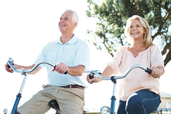 Senior couple bike riding at Clearwater at Riverpark in Oxnard, California