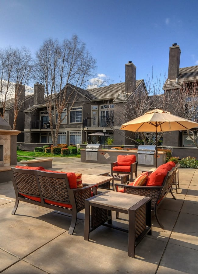 A resident patio with outdoor BBQ grills at Larkspur Woods in Sacramento, California