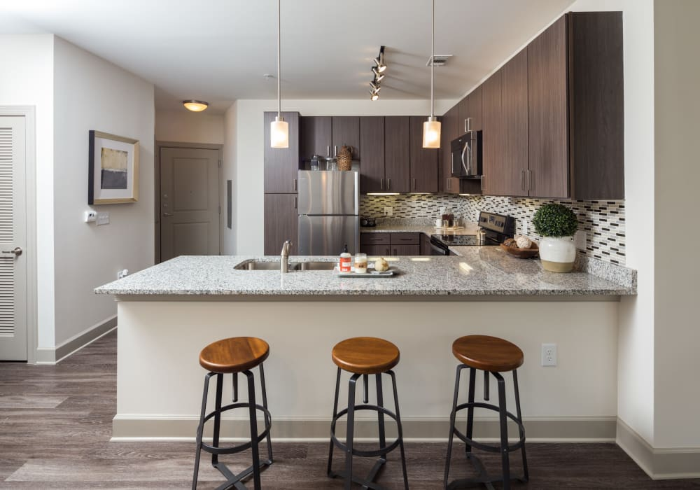 Enjoy a modern kitchen with breakfast bar at One Metrocenter in Nashville, Tennessee