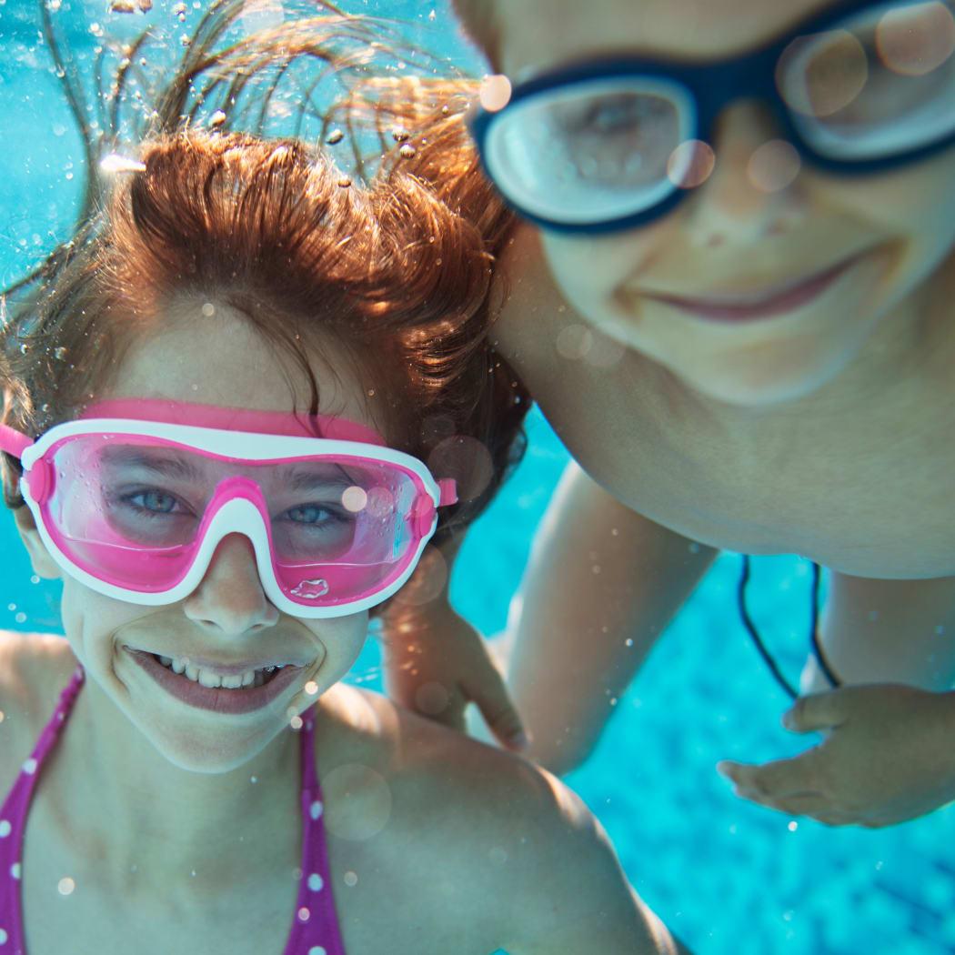 Kids enjoying the refreshing swimming pool at Avilla Northside in McKinney, Texas