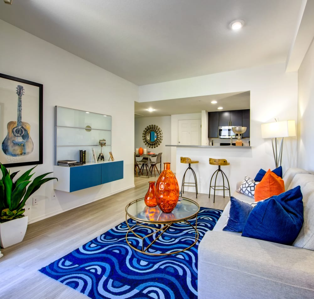 Well-furnished living area in a model home at Sofi at 3rd in Long Beach, California