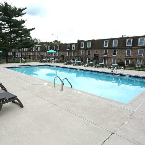 A large swimming pool with an expansive sundeck at Reserve at Lindsay in Louisville, Kentucky