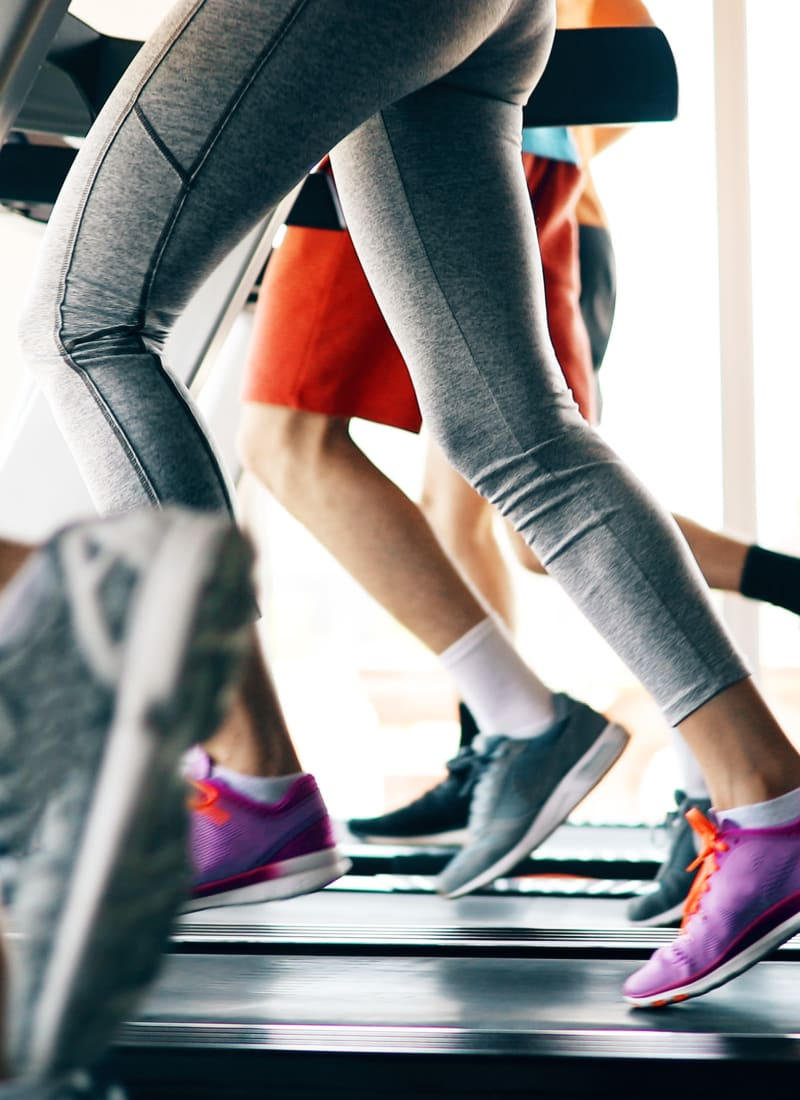 Residents running on treadmills at Marquis at Kingwood in Kingwood, Texas