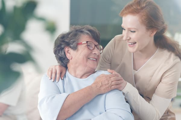 Happy resident receiving care at Grace Manor Assisted Living in Nashville, Tennessee
