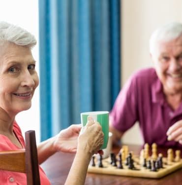 Residents playing chess at The Renaissance at Coeur d'Alene in Coeur d'Alene, ID