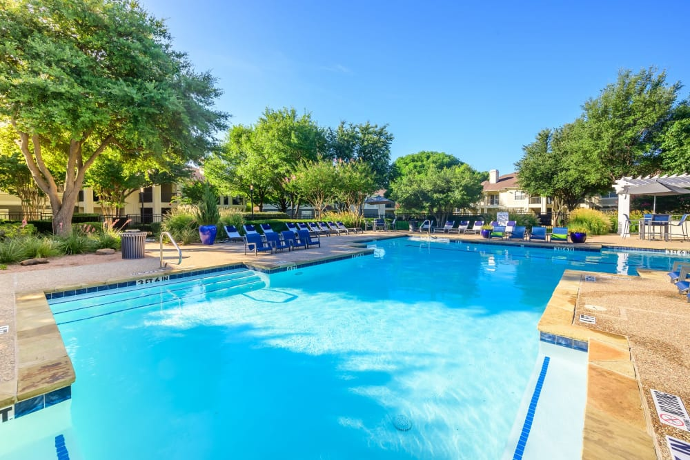 Resort-style swimming pool on a beautiful day at 23Hundred @ Ridgeview in Plano, Texas