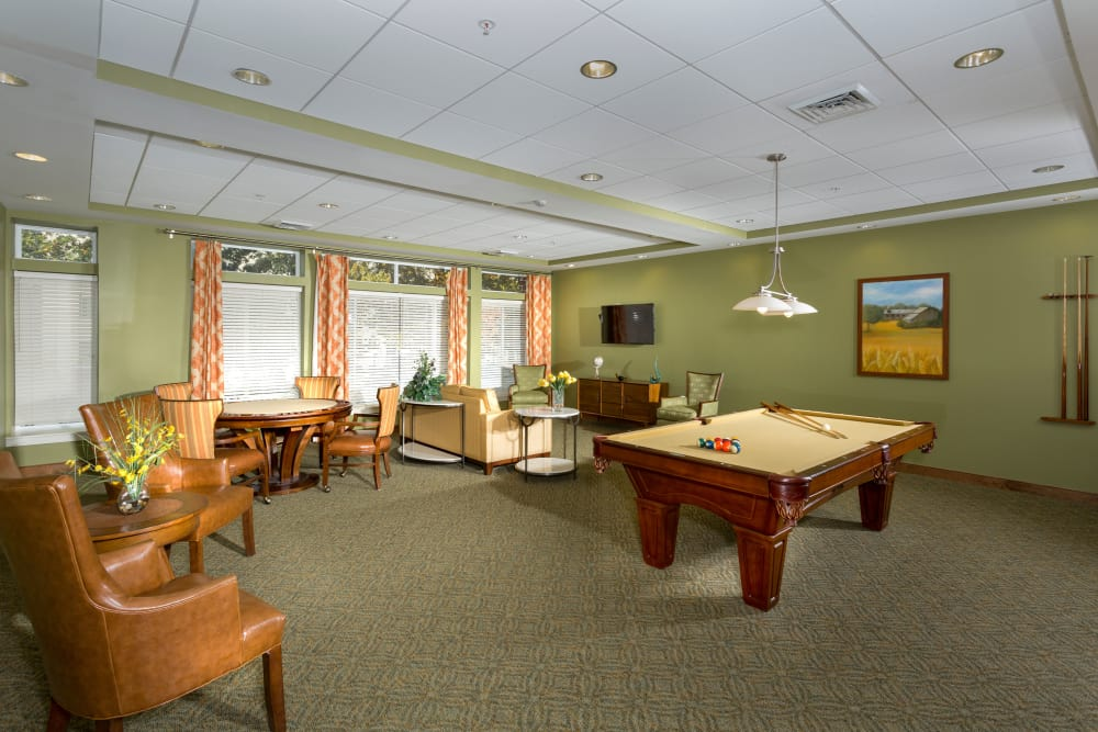 Spacious game room at Weinberg Manor in Baltimore, Maryland