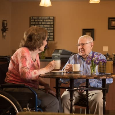 Resident talking with another resident at York Gardens in Edina, Minnesota