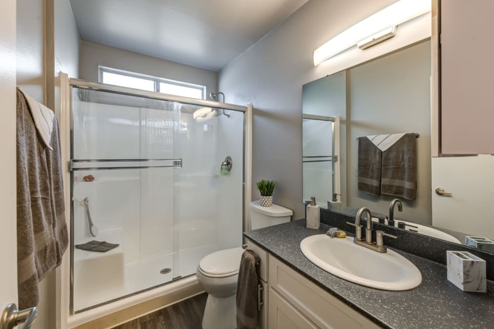 White cabinets in a renovated bathroom at Kendallwood Apartments in Whittier, California